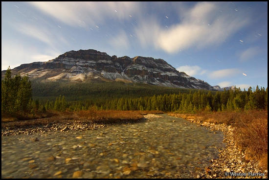 - Mosquito Creek and Bow Peak illuminated by moonlight, Banff NP, Canada -