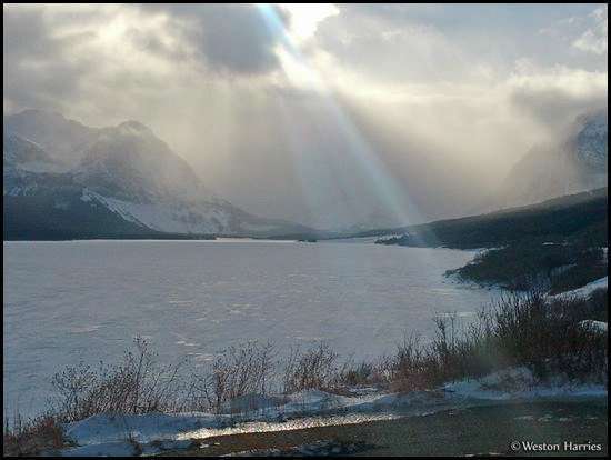 - Sun Beams Over Frozen Lake Sherburne, Glacier NP -