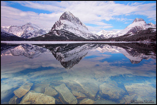- Swiftcurrent Lake Reflecting Mt. Gould, Grinnell Pt, Swiftcurrent Mtn, and Mt. Wilbur, Glacier NP -