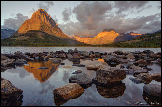 - First Light on Grinnell Pt. and Mt. Wilbur, Reflected in Swiftcurrent Lake, Glacier NP -
