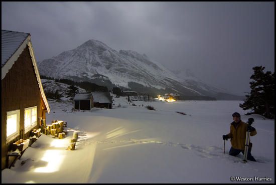 - Many Glacier Cabin and Winter Caretaker, with Allen Mtn Under Moonlight Behind, Glacier NP -