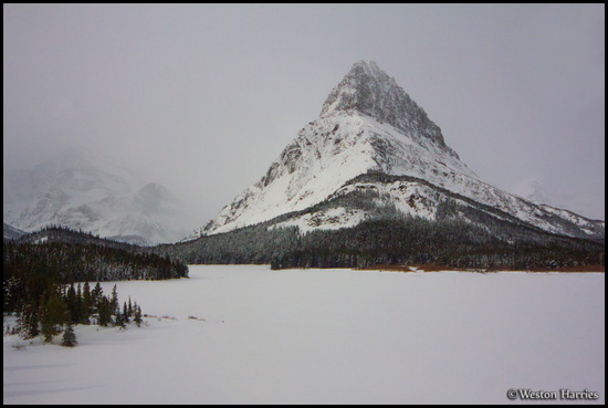 - Frozen Swiftcurrent Lake and Grinnell Point Under Moonlight, Glacier NP -