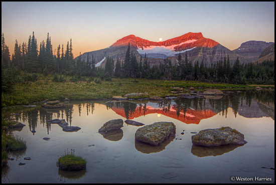 - Reflection of a Full Moon Setting Behind Piegan Mtn. at Sunrise, Glacier NP -