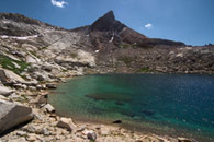 - Backpacker on the Shore of Upper Monarch Lake, Below Mineral Peak, Mineral King Area, Sequoia NP -